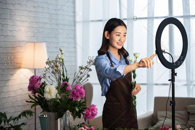 Young women live online flower art