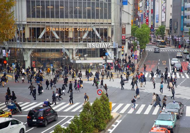 Tokyo, Japan - December 1, 2015: Pedestrians crossing street in the Shibuya ward of Tokyo