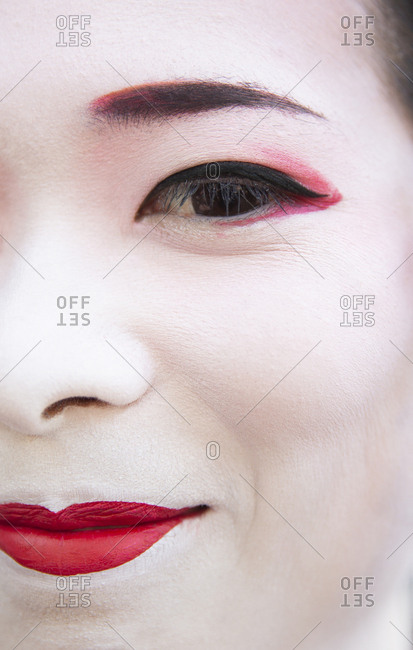 Kyoto, Japan - November 29, 2015: Close up portrait of Maiko training to be a Geisha smiling