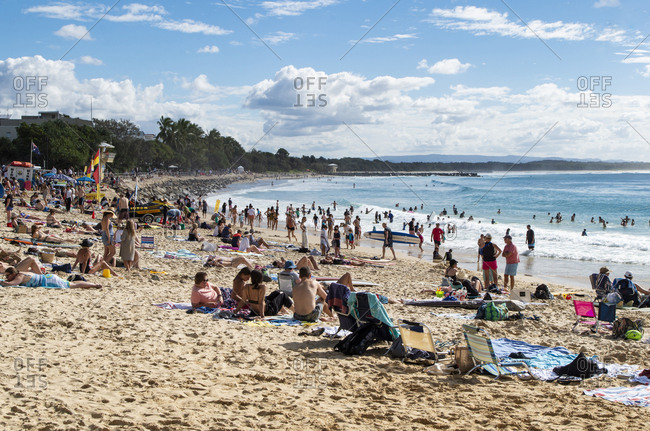 Noosa, Queensland, Australia - July 8, 2019: Beachgoers relaxing at the beach on a hot day