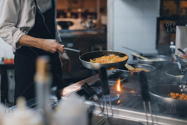 Chef preparing pasta in an Italian restaurant