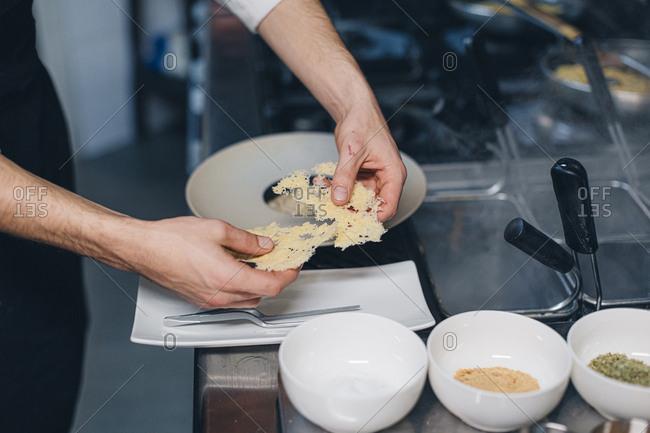 Chef preparing a dish in an Italian restaurant