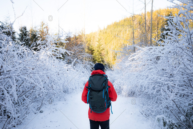 Man hiking through a snowy and icy path