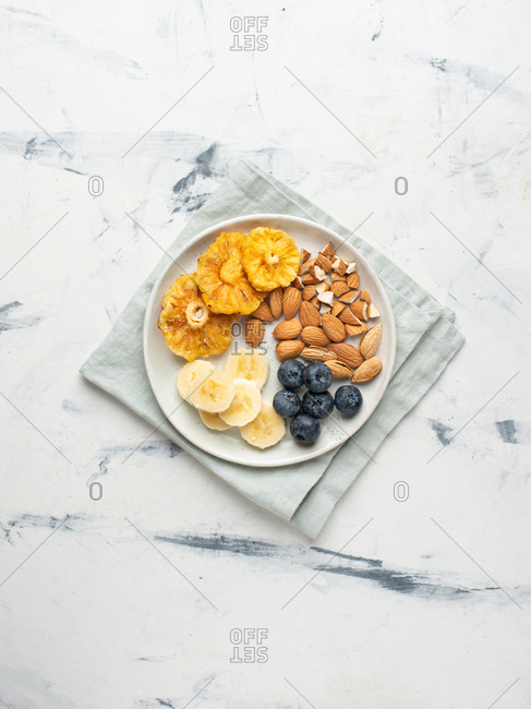 Breakfast plate with fruits, blueberry and almond