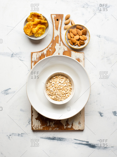 Oat bowl with dried pineapple and almond nuts from above
