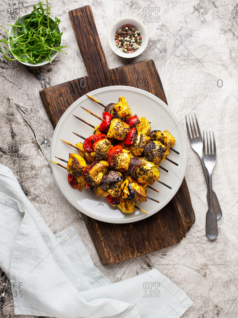 Skewers of chicken breast with grilled vegetables on a plate