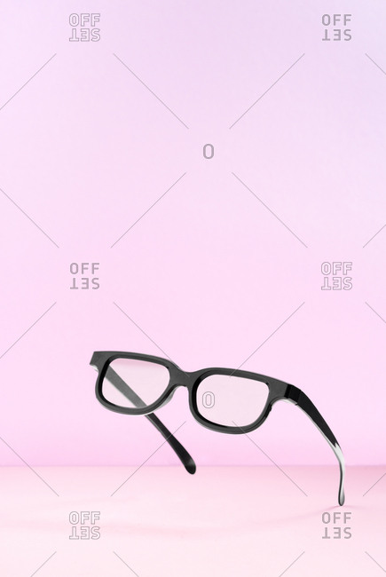 Pop art black frame sunglasses on pink background