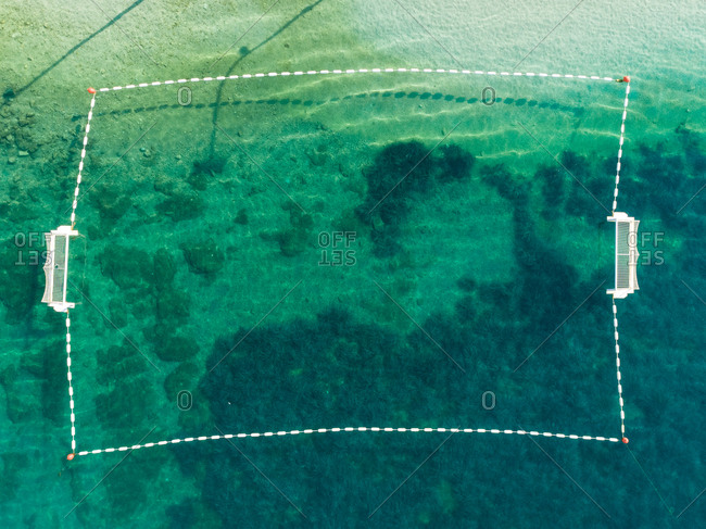 Aerial view of water polo field at transparent water, Sumartin, Croatia.