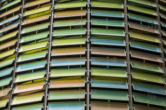 Colourful glass panels on a building facade in Berlin, Germany.