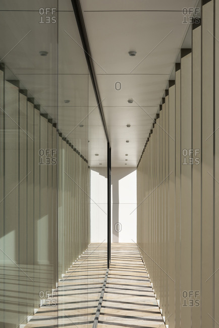 Architectural elements of modern building reflecting in windows