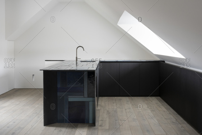Minimalistic modern kitchen with angled ceiling