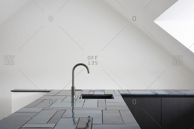 Minimalistic modern kitchen with tile counters