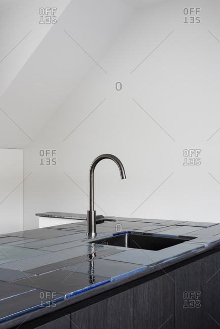 Minimalistic modern kitchen with blue tile counters