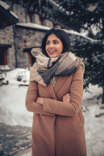 Portrait of a young woman with dark hair outdoors in winter