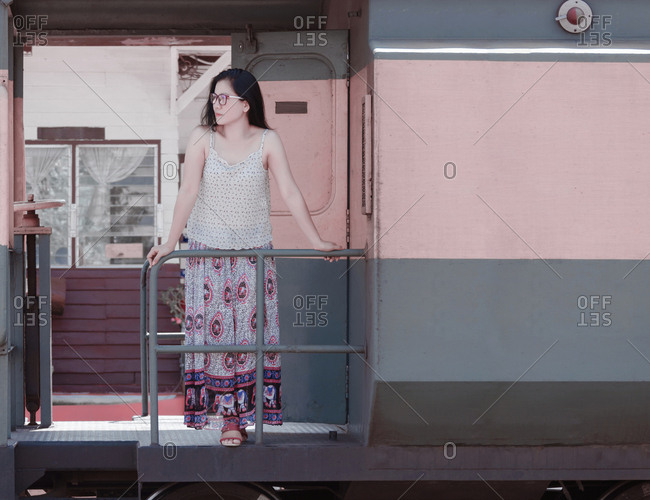 Woman standing on the train while travel in thailand