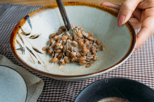 Cropped hand of woman mix a natto in bowl