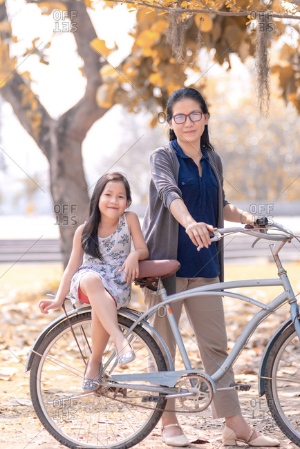 Mother and daughter and bicycle in weekend