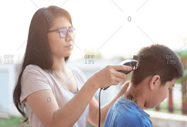 Mother cut hair for son