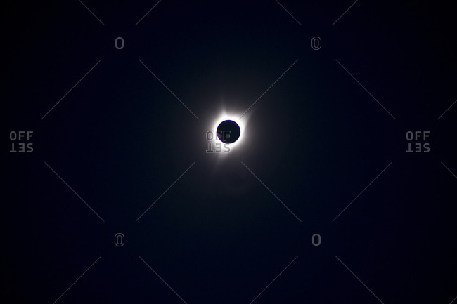Low angle view of solar eclipse at night