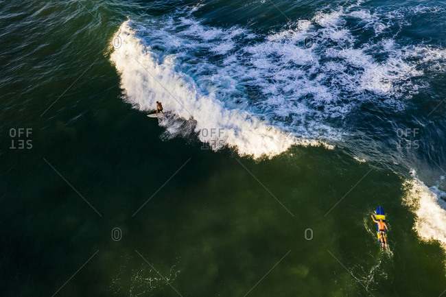 Aerial view of surfers and wave from above, burleigh heads australia