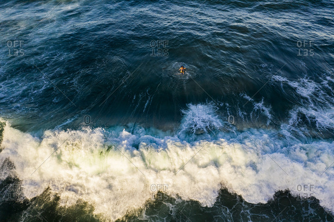 Aerial view of a surfer and breaking wave, burleigh heads, australia