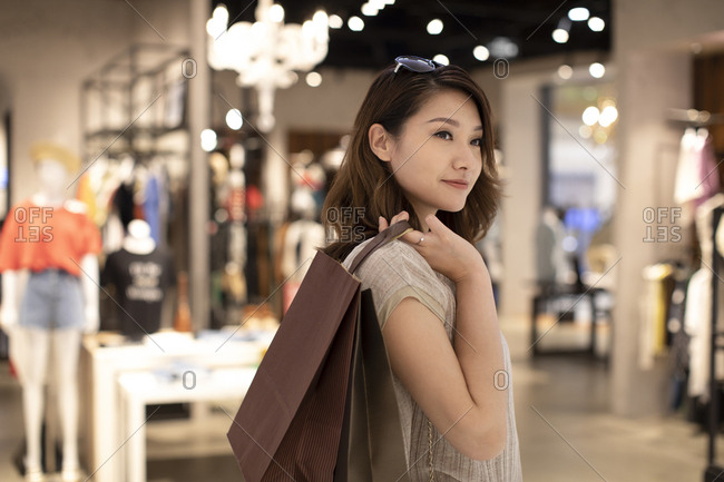 Elegant Chinese woman shopping in shopping mall