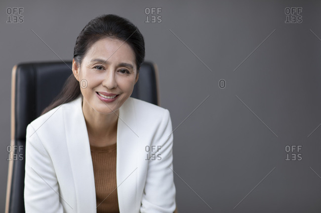 Confident mature Chinese businesswoman