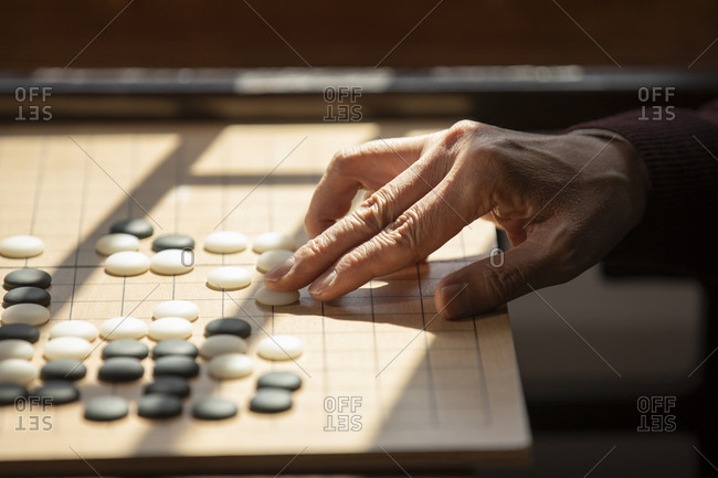 Senior Chinese man playing the game of go