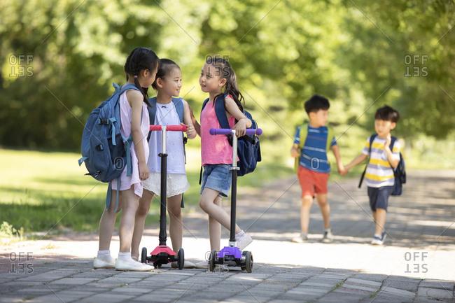 Happy Chinese children going to school