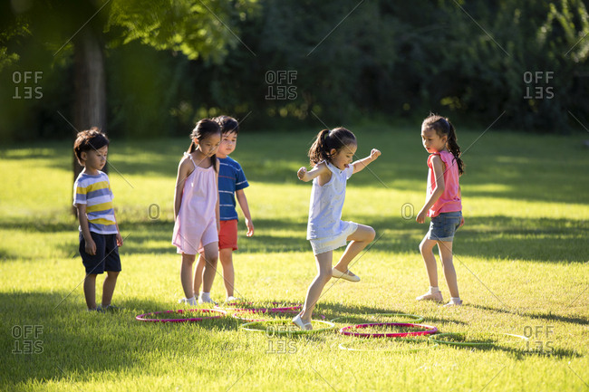 Happy Chinese children playing on meadow