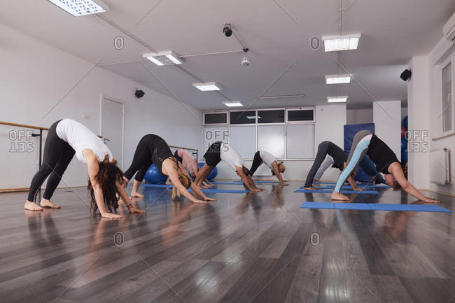 Group of people exercising together in pilates class