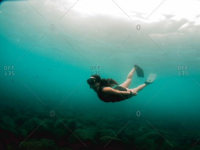 Young woman doing free dive in the mediterranean sea