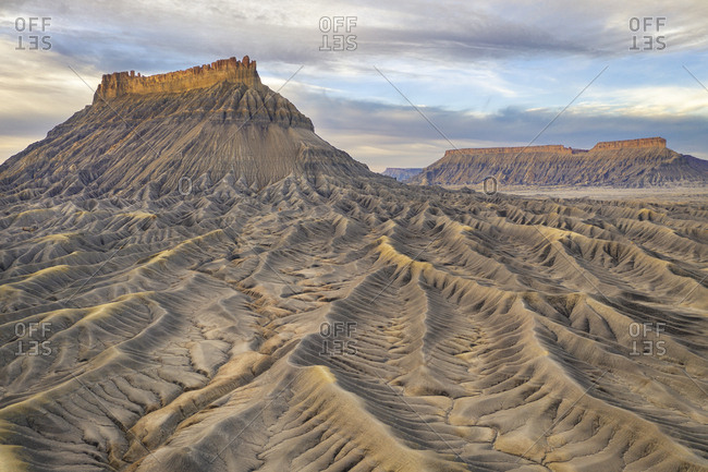 Aerial view of barren desert landscape with buttes and mesas