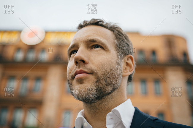 Close-up of thoughtful businessman looking away