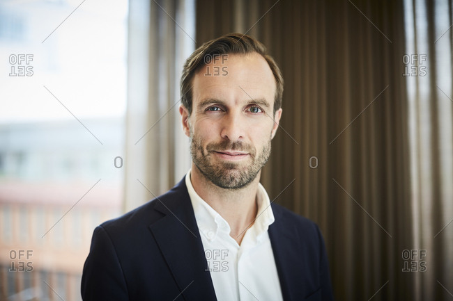 Portrait of male legal advisor in formals at office