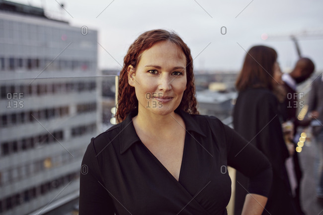 Portrait of confident businesswoman standing on terrace