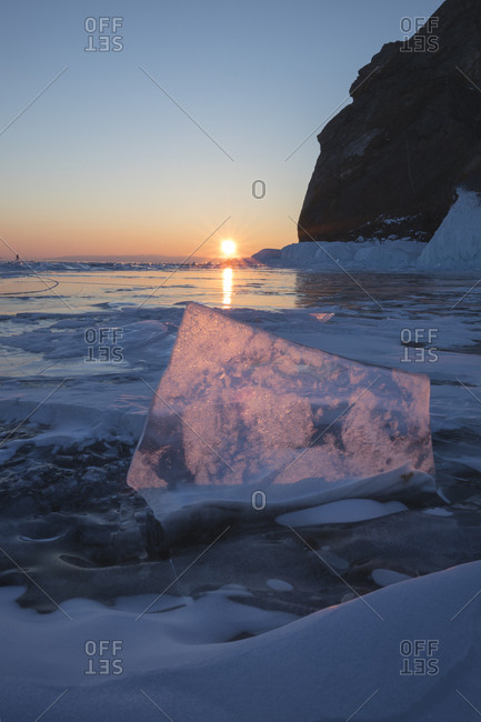 Crystal clear ice plate at sunset