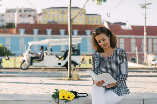 Woman reading outdoors.