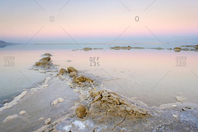 Salt deposits in the dead sea at sunset, ein bokek, israel