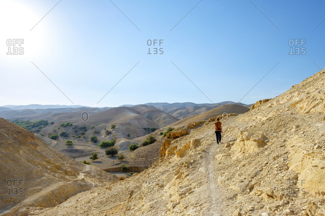 Hiker in wadi quelt, prat river gorge, jericho, west bank, palestine