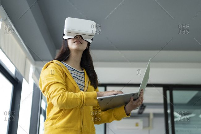 Young programmer with virtual reality glasses to testing 3d appl