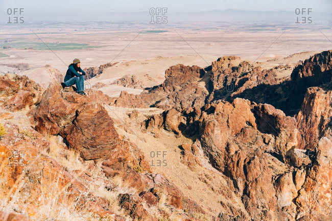 Woman admiring the view over a canyon.