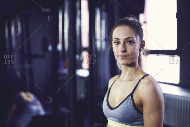 Portrait of young attractive woman at the fitness center
