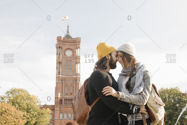 Young couple embracing with Rotes Rathaus in background- Berlin- Germany