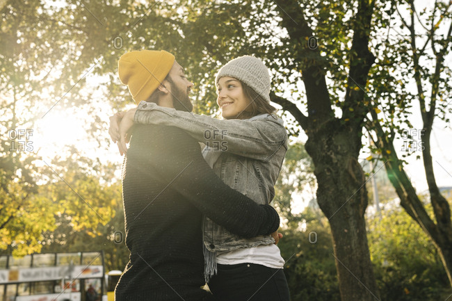 Young couple embracing in a city park- Berlin- Germany