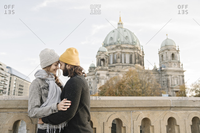 Young couple embracing with Berlin Cathedral in background- Berlin- Germany