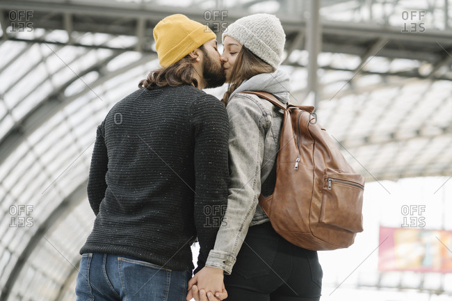 Young couple kissing at the station platform- Berlin- Germany