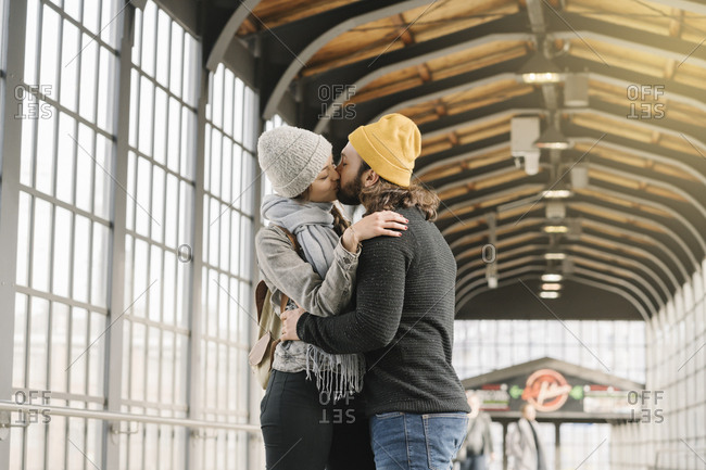 Young couple kissing at a subway station- Berlin- Germany