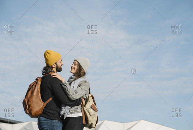 Young couple embracing in the city- Berlin- Germany