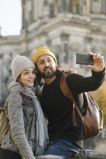 Young couple taking a selfie with Berlin Cathedral in background- Berlin- Germany